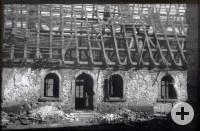 Ein Foto der zerstörten alten Schule nach dem 2. Weltkrieg.